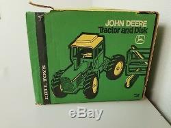 Ertl John Deere 7520 four wheel drive tractor and disk set. New in box. NIB