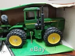 Ertl John Deere 8650 four wheel drive tractor and disk set. New in box. NIB